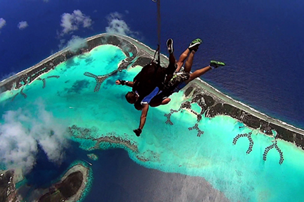 Amazing Race Contestants Skydiving in Bora Bora